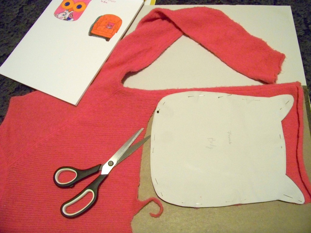 cutting out the pattern for an owl stuffy