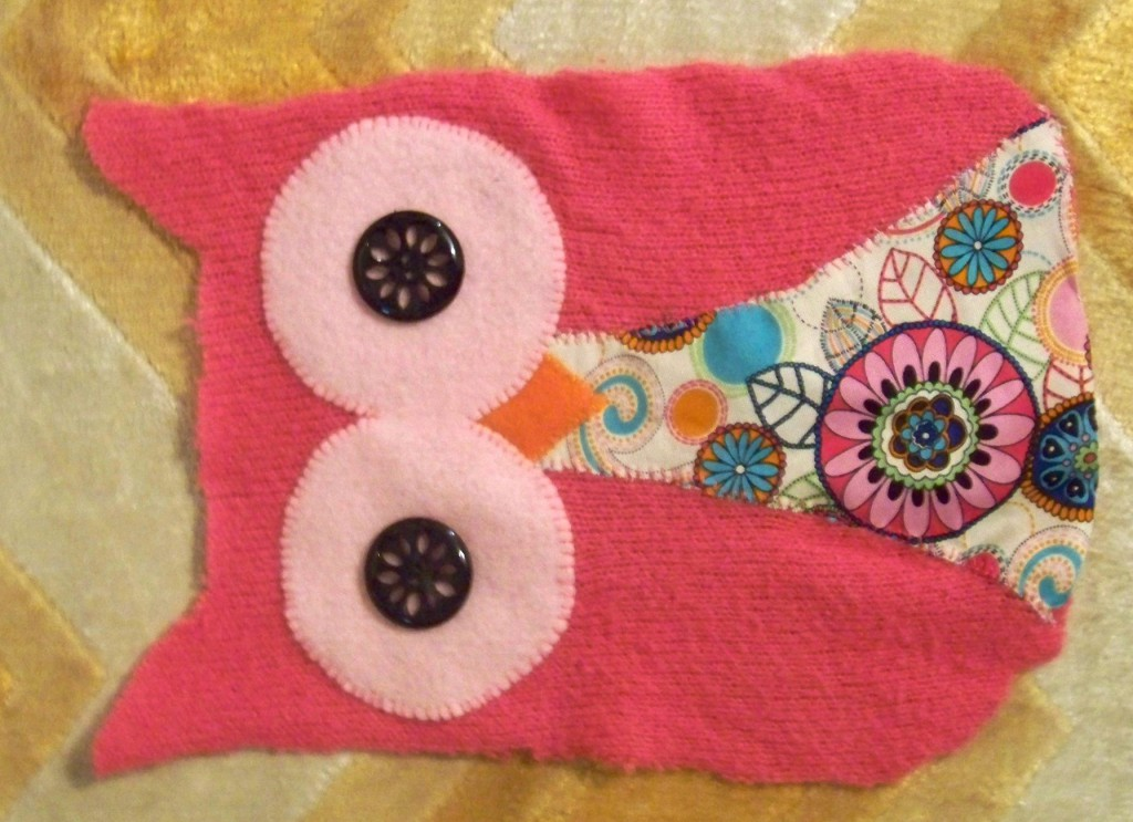 the front of the owl plushie, with all the feature sewn on