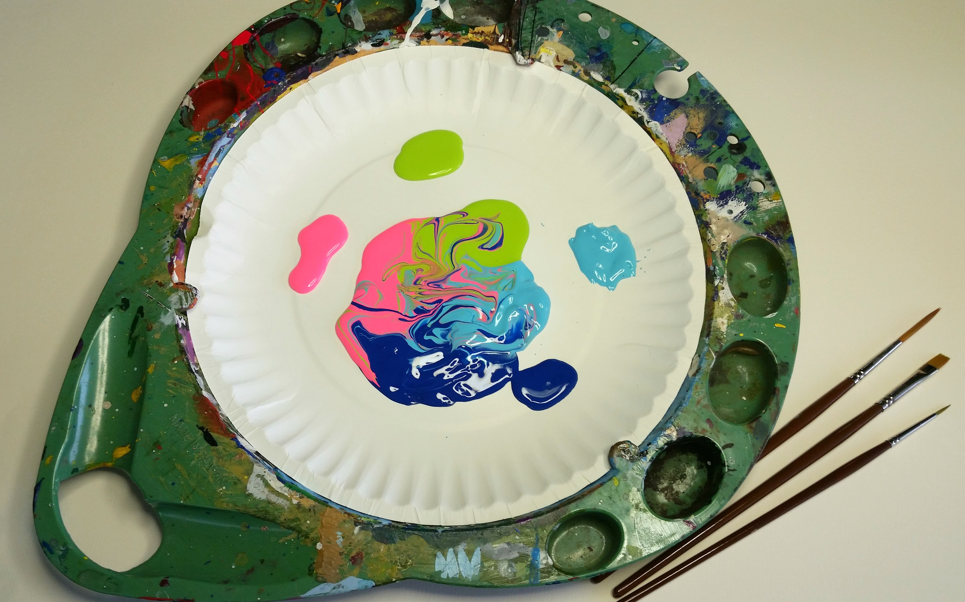 FolkArt One Stroke Palette with colorful paint on it