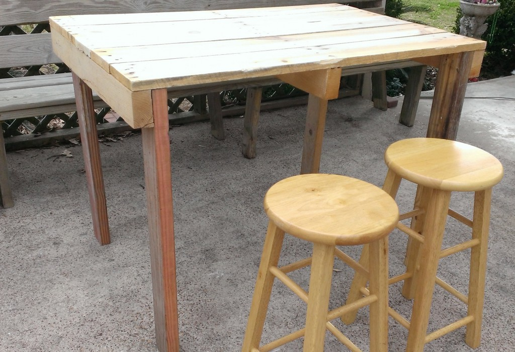 the outdoor pub table is ready to be finished