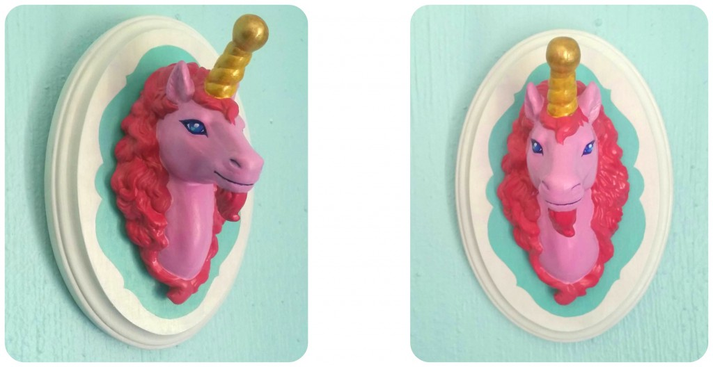 the unicorn head mounted on a teal plaque, completed