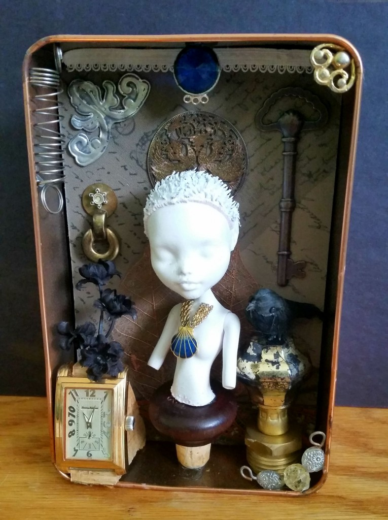 the assemblage of the doll bust has come together now