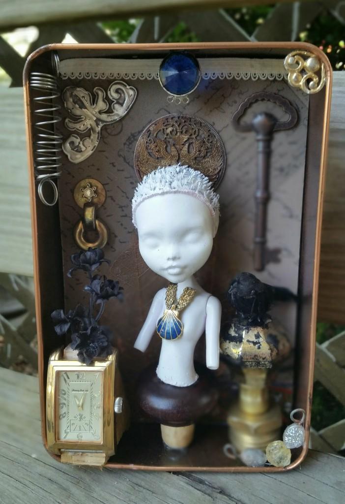 an ornate semi-steampunk doll assemblage