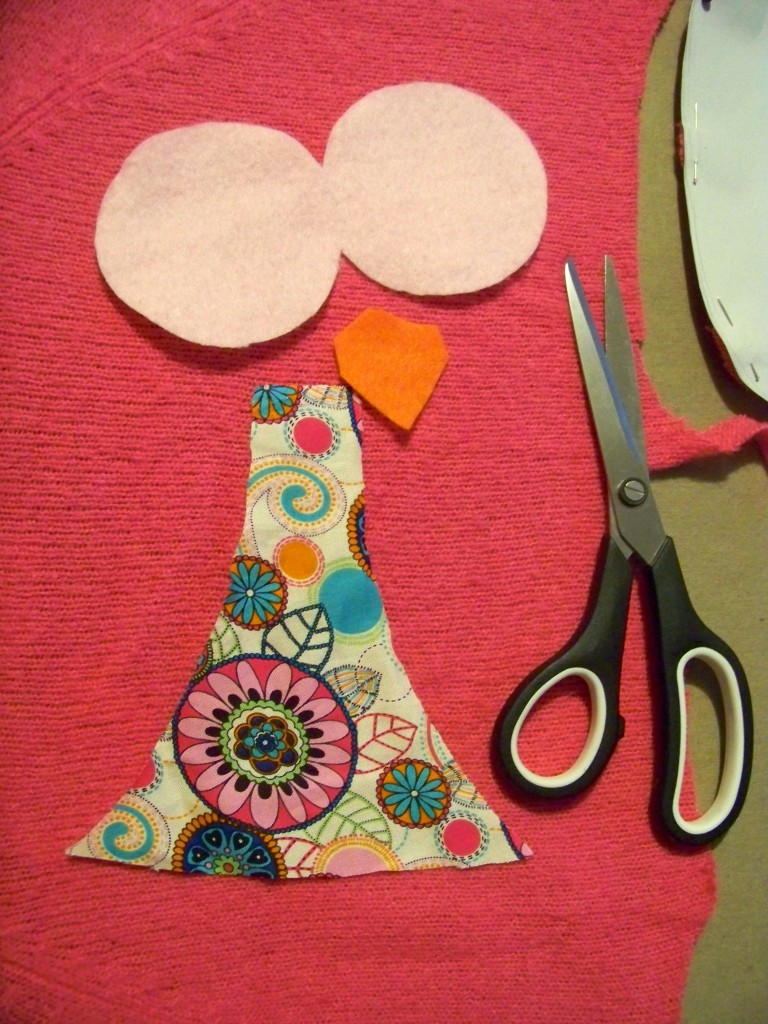 cutting out the embellishments for a cute owl throw pillow
