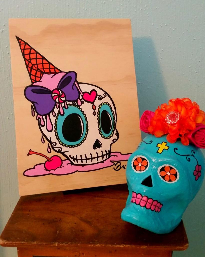 sugar skull wood painting on display