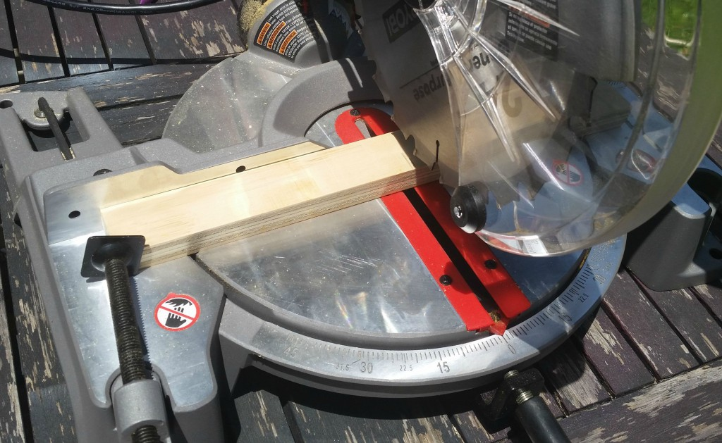 using a saw to cut wood