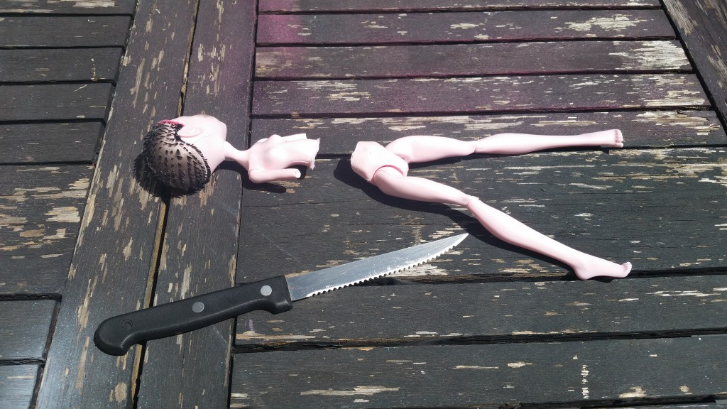 sawing a doll in half